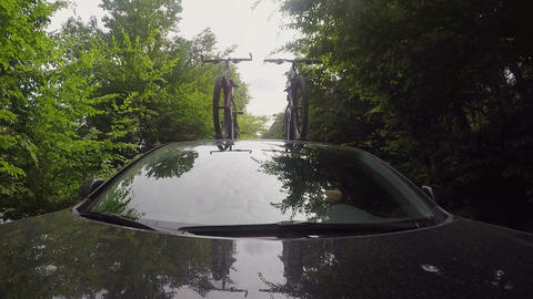 Front view. Car rides on a forest road with bikes on the roof Footage