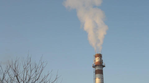 Smoke coming out of industrial brick chimney Footage