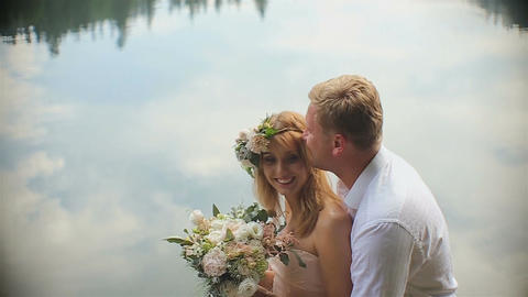 Close-up.Young romantic pair - pretty girl in long light dress and handsome man  Footage