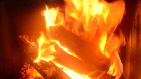 Logs burning in an iron-cast fireplace Footage