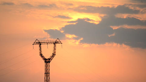 Time lapse with transmission tower and cumulus clouds at dawn Filmmaterial
