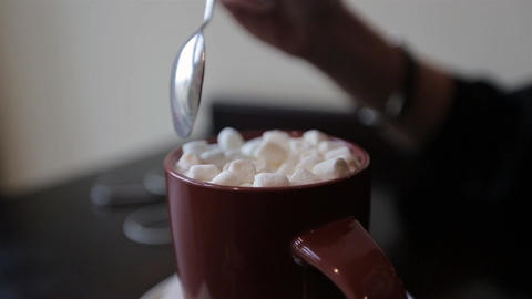 cocoa with marshmallows.women takes a spoon of cocoa with marshmallows Footage