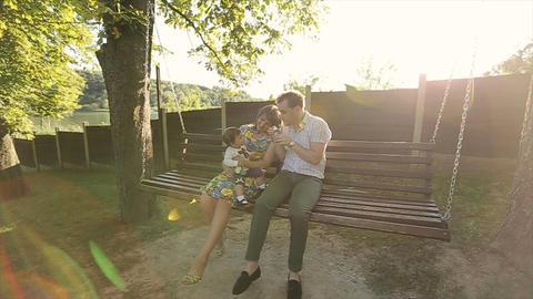 Cute little girl having fun with bubble. Happy family have fun in backyard. Litt Footage