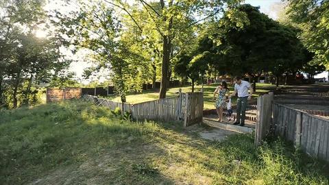 Happy family walking in backyard.Happy family in backyard holding hands Footage