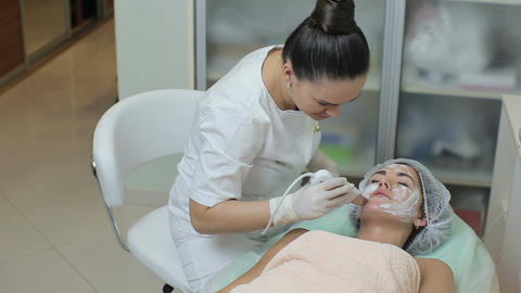 High angle view of woman lying on the couch in cosmetic cabinet while beautician Footage