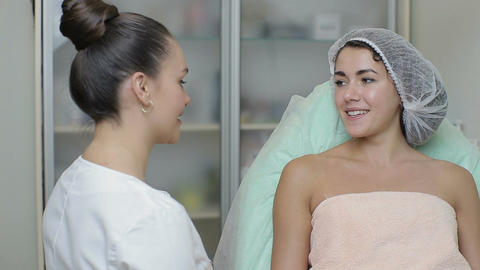 Beautician talking to a young girl about the upcoming procedure Footage