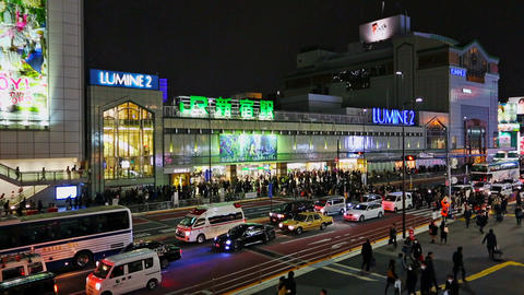 Shinjuku train station and Koshu-Kaido Avenue in evening rush hour Footage
