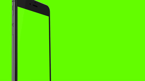 Smartphone turns on on Green background. Easy customizable green screen. Compute Archivo