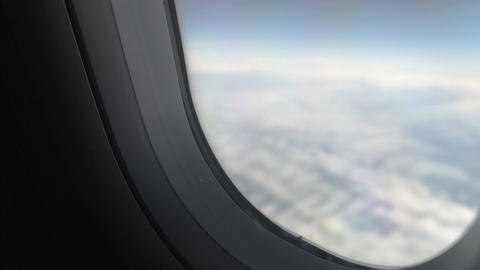 Hand of plane passenger shutting window shade to have rest during long flight Footage