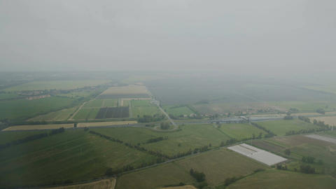 Flight over green cultivated farming fields, crop harvesting, sowing campaign Footage