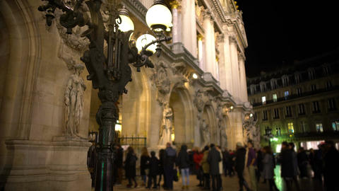 View on antique streetlight and people entering Opera house in Paris, France Footage