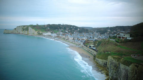 Etretat coastline, view on town from mountain top, famous resort place in France Live Action