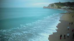 People walking on beach and enjoying view on English Channel, Etretat coast Footage