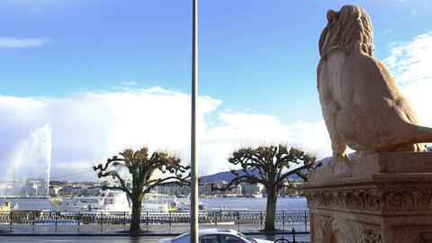 Beautiful view on Geneva lake and famous fountain under blue sky, plane trees Footage