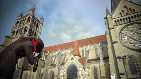 Tourist taking photos of famous Lausanne Cathedral in Switzerland, sightseeing Footage