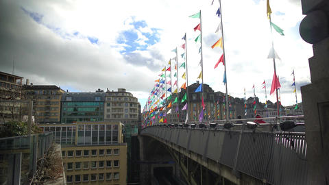Lausanne bridge with colored flags under cloudy sky, holidays in Switzerland Footage