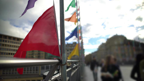Colored flags waving in the wind on Lausanne bridge in Switzerland, urban life Footage