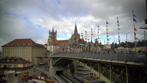 Lausanne bridge decorated with colored flags and ancient city architecture Footage