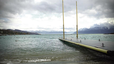 Geneva Lake on winter day, view of Alps mountains from pier, beautiful nature Footage