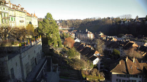 Tile roofs of cozy houses, panorama of old European city on a sunny day Footage