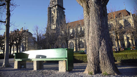 Empty bench on beautiful square near ancient Bern Minster cathedral, sunny day Footage