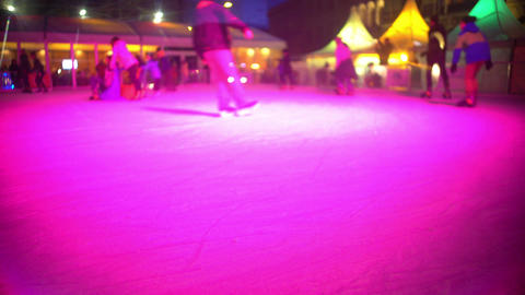 Children and adults skating on ice and enjoying weekend, active holidays Footage