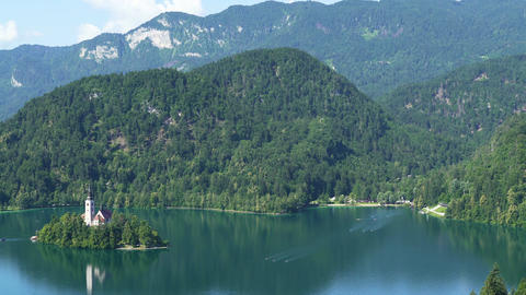 Lake Bled and Julian Alps in Slovenia, fantastic aerial view, tourist attraction Footage