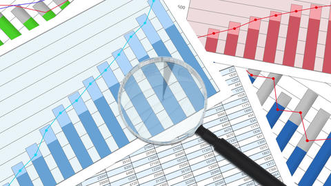 Closeup of magnifying glass on financial charts and graphs, statistics, analysis Footage