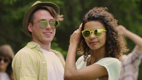 Young smiling couple looking at camera, enjoying summer weekend with friends Live Action