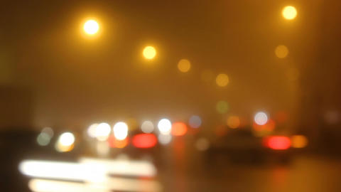 Blurred lights of city in fog and cars on road Footage