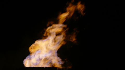 Burning torch at the metallurgical plant at night Live Action
