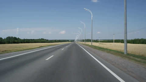 Moving along Asphalt Road Towards Horizon with Trees and Sky Footage