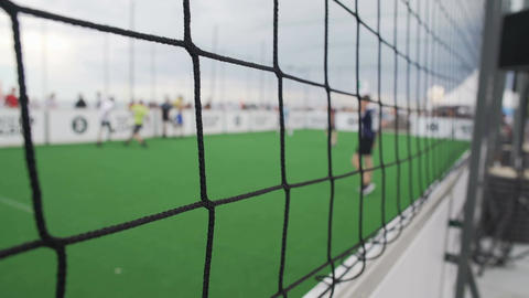 Active lifestyle, people playing football game outdoors, amateur sports Footage