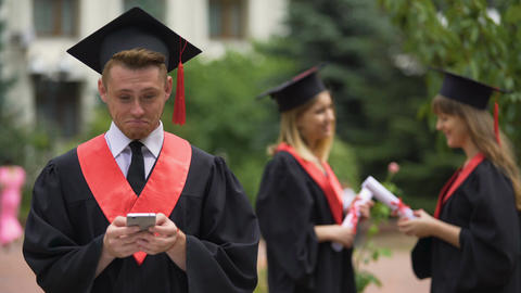 Graduate checking job offers on smartphone, reading messages in social network Footage