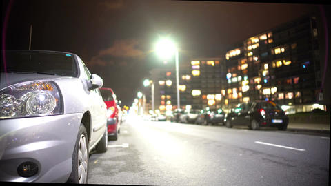 Cars parked near modern residential complex, evening time, transportation Footage