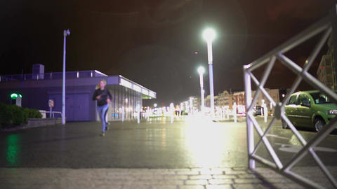 Woman running on sidewalk at night, healthy lifestyle, weight loss exercise Footage