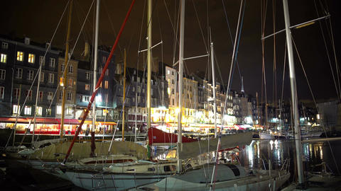 Beautiful French city at night, boats and yachts parked near embankment Footage