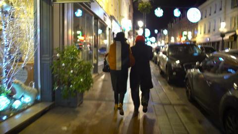 Pedestrians walking on sidewalk, POV of jealous wife following cheating husband Footage