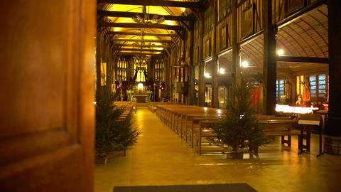 Relaxing atmosphere in old wooden church hall, place of worship, spirituality Live Action