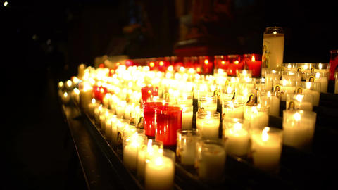 Beautiful candles burning in church, evening worship service, time for prayer Footage