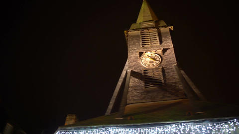 Panorama of stone clock tower in city center, sightseeing, ancient architecture Footage
