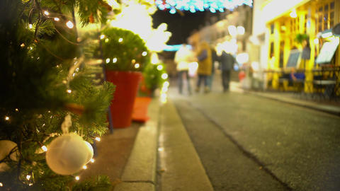 Happy people walking on decorated street on New Years Eve, holidays, relaxation Footage