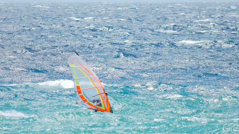 Windsurfing champion sailing on waves of blue ocean, summer vacation and sport Footage