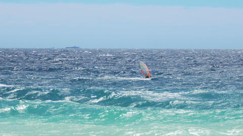 Strong windsurfer sailing on waves in summer, active healthy lifestyle, slow-mo Footage