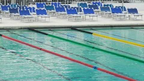 Relaxing view on empty pool with clear water and tracks for swimming, sport Footage