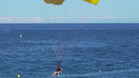 People with parachute landing in sea, parasailing, extreme sport, active life Footage
