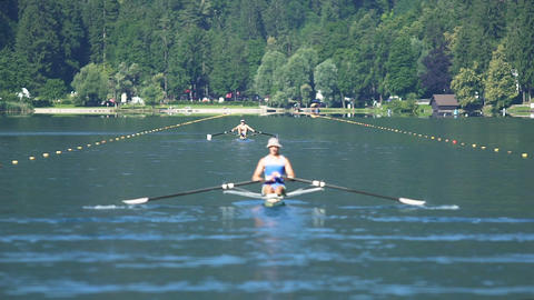Two athletes competing in rowing, professional sport and healthy lifestyle Footage