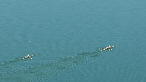 Top view on teams paddling across lake, professional rowing sport, competition Footage