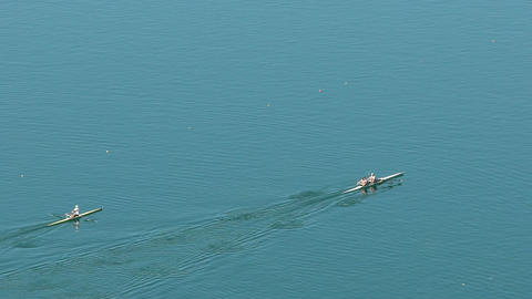 Boat-racing training, professional rowers enjoying water sports, summer vacation Footage