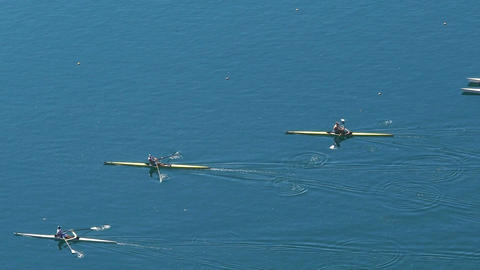 Rowing race between three participants, professional water sports, slow motion Footage